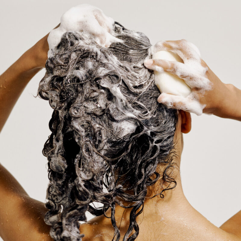 Shampooing hair with lathering bar
